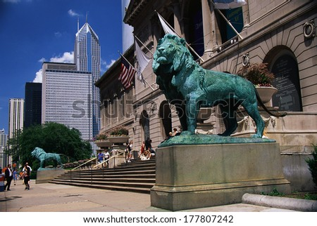 This is the exterior of the Art Institute of Chicago. The famous lion statues are guarding its entrance. - stock photo