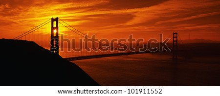 This is the Golden Gate Bridge in San Francisco at sunrise. - stock photo