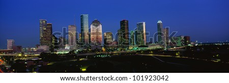 This is the Houston skyline at sunset with Memorial Park in the foreground. - stock photo