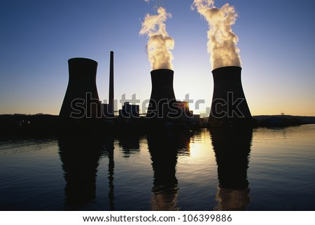 This is the John Ames Power Plant. It is a coal utility company located on the Kanoa River at sunset . - stock photo