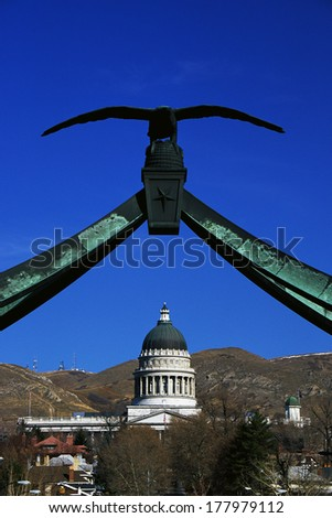 This is the State Capitol building with the eagle gate above it. It was taken from State Street & South Temple Street. The city will be the site of the 2002 Winter Olympics. - stock photo