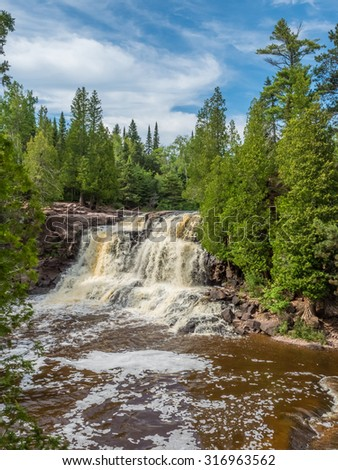 This is the Upper Falls at Gooseberry Falls State Park in Minnesota. This is in the Lake Superior North Shore Area. - stock photo