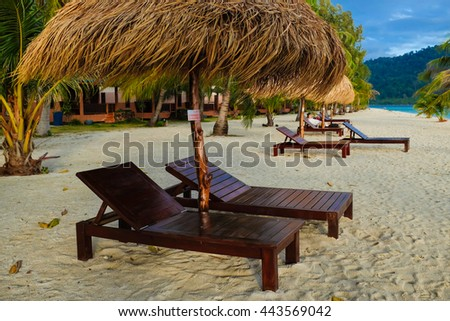 This is the vacation time show wood chairs on a beautiful tropical beach with white sand and clear turquoise ocean at exotic island - stock photo