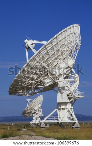 This is the Very Large Array or VLA at the National Astronomy Observatory. It represents communications. - stock photo