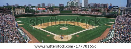 This is Wrigley Field. The Chicago Cubs are playing the Colorado Rockies. They played to a sold out crowd of 40,751. The final score was Cubs 7, Rockies 0. - stock photo
