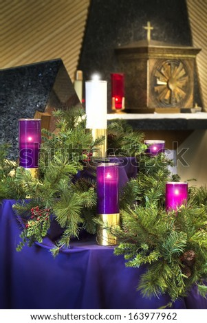 This large Christmas Advent Wreath is on display to celebrate the Catholic Christmas Holiday season.  - stock photo