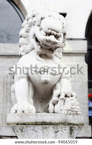 This lion statue is the guardian of palace and this mythical animal is regarded to protect city and palace against fire in East Asia. - stock photo