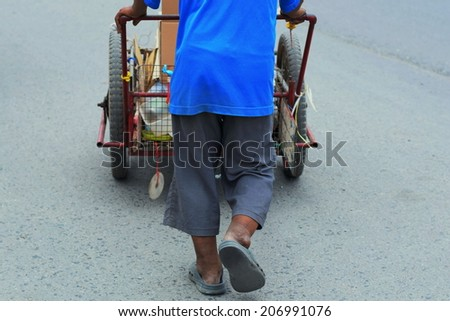 this man walking and searching recycle garbage for sell