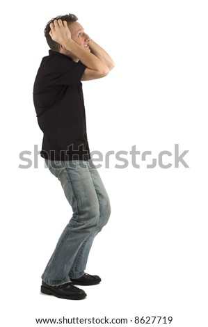 This man would like to tear his hair out, he's that scared. - stock photo