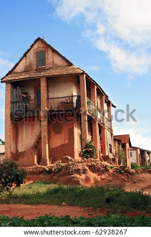This old colonial house is in the outskirts of Antananarivo. The colors are really like this in Madagascar, naturally saturated. - stock photo