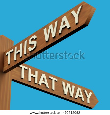 This Or That Way Directions On A Wooden Signpost - stock photo