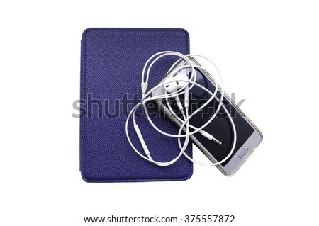 This photo displays an E-book reader with a mobile phone and the headphones isolated on white surface - stock photo