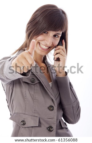 This photo shows a business woman talking on the phone.