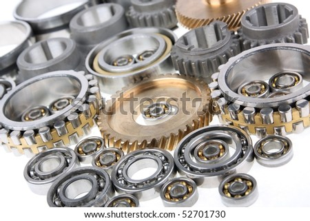 This photo shows the gears and bearings on white background