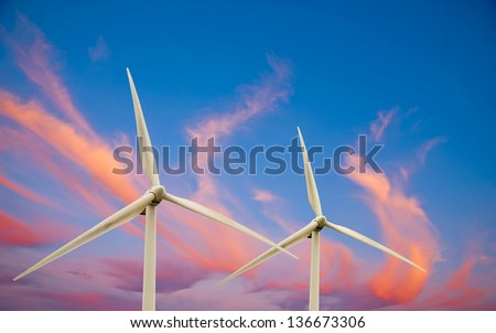 This photo shows two wind turbines.