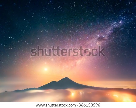 This photo was captured on Bali (Indonesia) just before the sunrise from the peak of Mt. Batur (1,717 m) with a view of Abang (2,151 m). To the left from it is a dazzling Venus. - stock photo