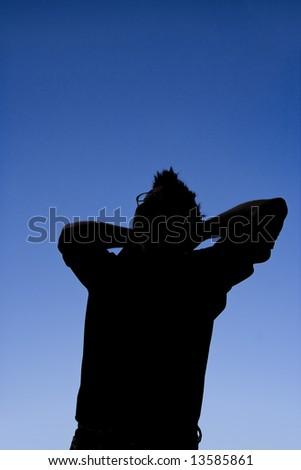 This photographic silhouette has some nice shadow detail. It is an image of a man relaxing and looking content.