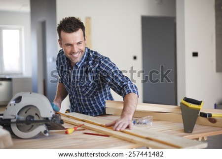 This plank will be perfect for new bookshelf - stock photo