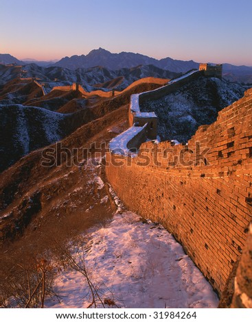 This section, Jin Shanling, is the most beautiful part of the whole Great Wall, which maintains its wild nature and with no artificial trace or marks. - stock photo