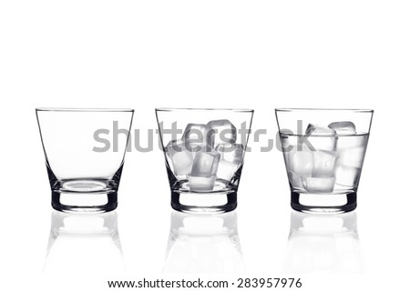 This set of glass included : empty glass and glass of water with ice - stock photo