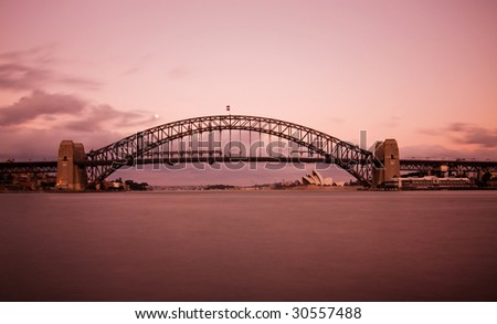 This shot was taken shortly after sunset from Milson Points. Famous Sydney Harbour Bridge taken during pink twilight conditions. - stock photo