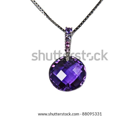 This stock image is a large, round genuine amethyst stone as a pendant on a necklace in fine jewelry, against a white collar display. - stock photo