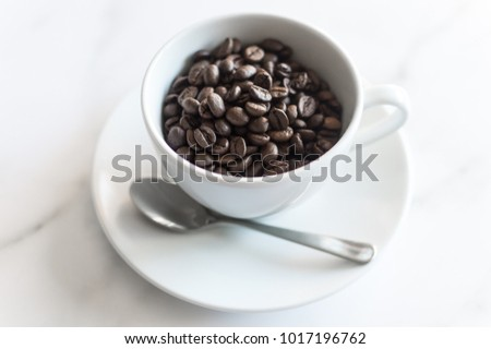 This stock photo of coffee beans in a white coffee cup is a great background for your blog post or shop announcement. Use this stock photo to caffeinate your social media feed.