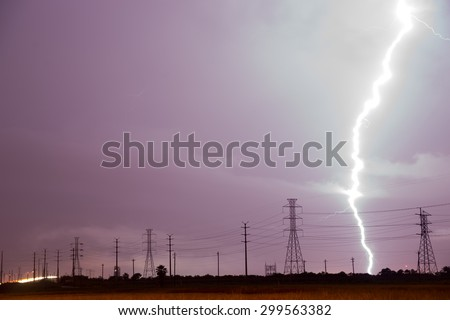 This thunderstorm is getting a little too close for comfort over power lines south Texas - stock photo