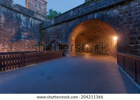 This tunnel is the amazing entrance to Nuremberg through the thick city walls that originally protected the city. - stock photo