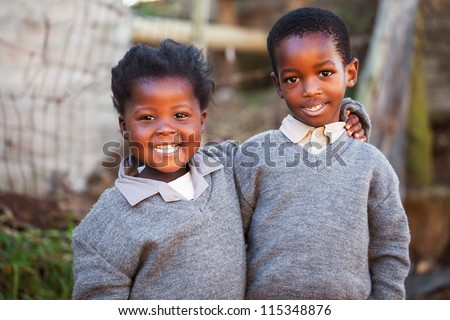 This two children have been friends since they were able to walk. - stock photo