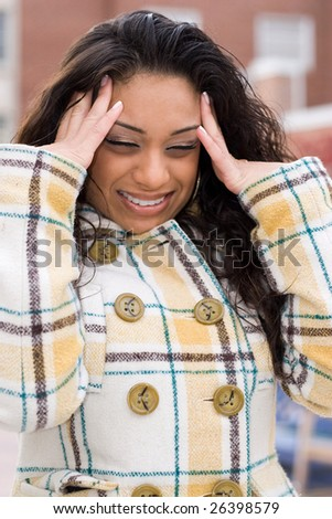 This woman is experiencing an intense headache. - stock photo