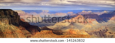 This XXL majestic scenic photo at the South Rim of the Grand Canyon captures the amazing layers of landscape and quality of light. - stock photo