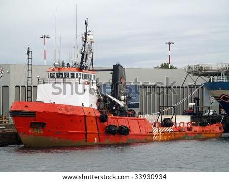 This 35 year old, 205 foot, 7200 HP Arctic Class II supply ship operates on Canada's three coasts, one of them seasonally. Built as Canmar Supplier.  Note the Inuktitut script writing on the bow.   - stock photo