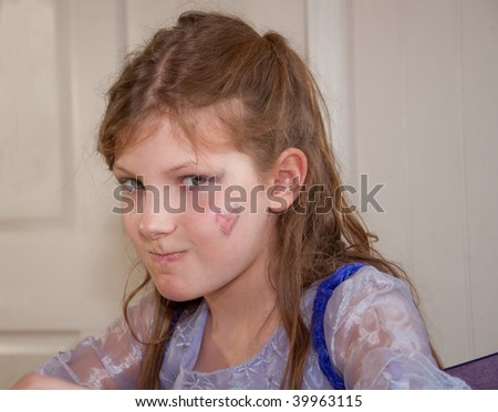 This 9 year old is crabby and her facial expression lets you know perfectly the emotion she's feeling. - stock photo