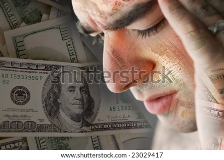 This young man is experiencing intense stress over a time of economic downturn or other financial hardship. - stock photo