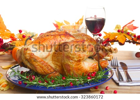 Thnaksgiving dish - turkey with pumpkins and fall leaves isolated on white background - stock photo
