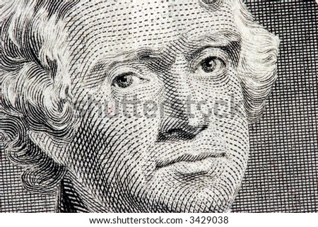 Thomas Jefferson close up from two dollar bill - stock photo