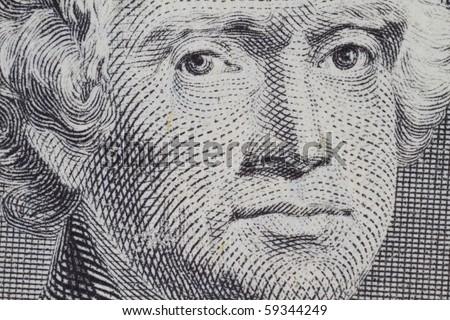 Thomas Jefferson closeup on the two dollar note - stock photo