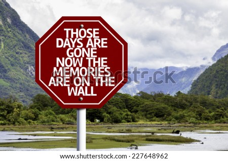 Those Days Are Gone Now The Memories Are On The Wall written on red road sign with landscape background - stock photo