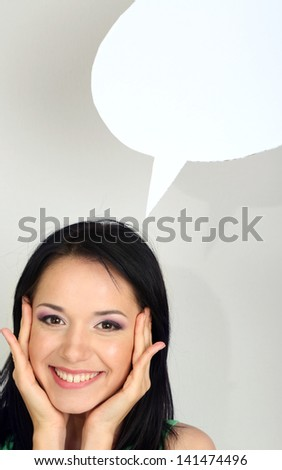 Thought girl in bubble next to it on grey background - stock photo