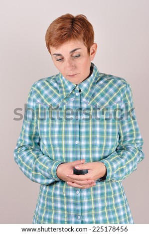 Thoughtful and sad woman with short hair looking down - stock photo