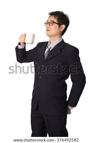 Thoughtful Asian businessman holding cup of coffee and looking away while standing, coffee break. isolated on white background