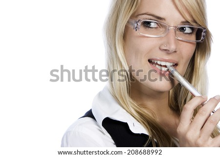 Thoughtful attractive young woman wearing modern glasses biting her pen as she stares off to the side with a contemplative expression, isolated on white with copy space - stock photo