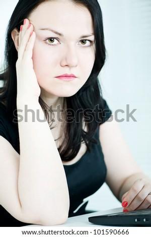 Thoughtful beautiful brunette woman - stock photo