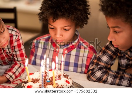 Thoughtful boys near birthday cake. Afro kid's small birthday party. Find peace inside yourself. Becoming adult little-by-little. - stock photo
