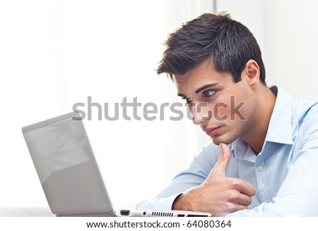 thoughtful business man at the notebook - stock photo