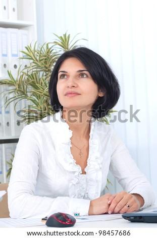 Thoughtful business woman - stock photo