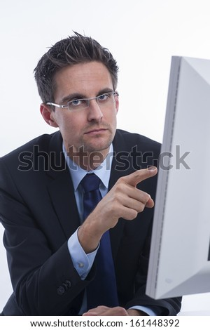 Thoughtful businessman in front of a screen