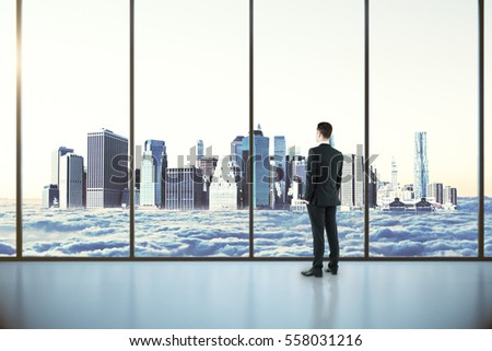 Thoughtful businessman in modern interior with panoramic windows with city in clouds view. 3D Rendering