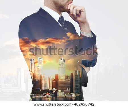 Thoughtful businessman on city background with sunlight. Double exposure